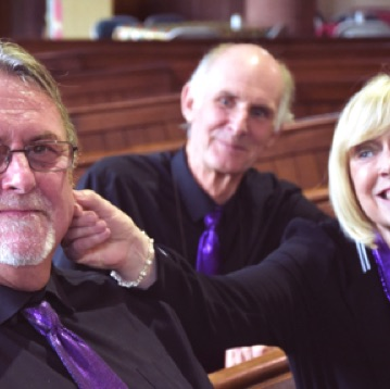 SingMe members Gordon, Ann and John getting ready for a performance at All Saints Church in Chester