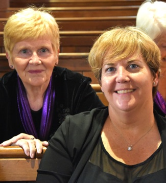 SingMe Bebington members, Jean and Karen, before a performance at All Saints Church, Chester
