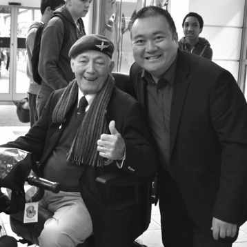 SingMe Merseyside's Founder and Musical Director, Billy Hui, pictured here with a regular audience member and war veteran