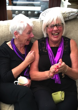 SingMe Bebington members, Julie and Pauline having fun following a performance for Macmillan Cancer Charity