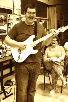 SingMe Local Solutions member, Kevin, pictured here with his trusty alpine white Fender Strat as featured on our versions of Bohemian Rhapsody and Mr Blue Sky