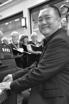 SingMe Founder and Musical Director, Billy Hui finds time to pose for a photo at this year's Tickle The Ivories - The Liverpool One Piano Festival